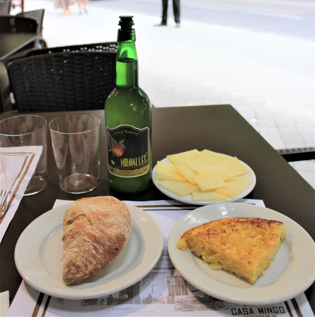 Spanish tortilla, queso de oveja, pan, and Sidra Natural